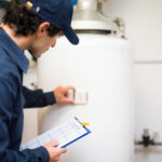 If your water heater is leaking, it could be a sign that your heater is dying. Here are 6 signs that you need to call a plumber right away.